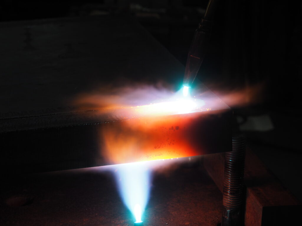 Close up of forging process by Rudolf Bott on steel